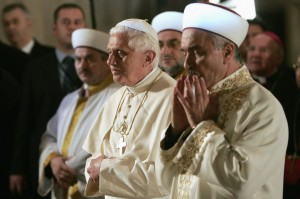 Benedict & Mustafa Cagrici Grand Mufti of Istanbul pray in the Blue Mosque in 2006 in Istanbul